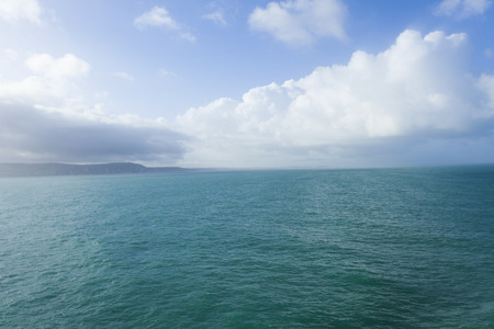 English Channel sea view leaving Dover, with blue sky and clouds photo
