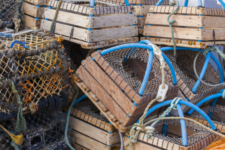 lobster pots: Stacked fishermans  lobster pots close up Folkestone harbour, Kent, UK Stock Photo
