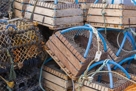 fishermans net: Stacked fishermans  lobster pots close up Folkestone harbour, Kent, UK Stock Photo