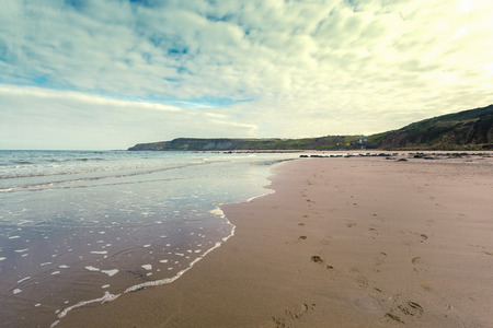 Retro Beach with footprints in the sand at Scene Cayton Bay, Scarborough, North Yorkshire, East Coast, UK photo