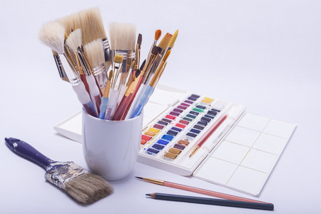 pallete: artists painting and drawing materials with watercolours, brushes and pencils