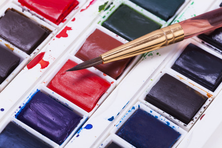 pallete: Artists watercolour paints  with brushes and pencil background hobbies and leisure time