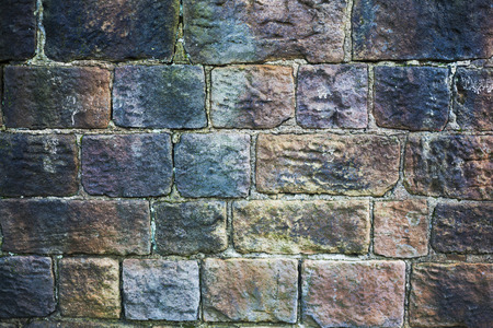 Grungy stone wall background and texture