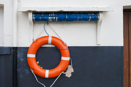lifesaving: Orange and white lifesaving lifebelt on sea front at Scarborough, Yorkshire, United Kingdom Stock Photo