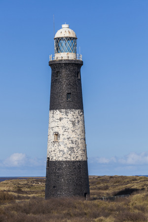 spurn: Spurn Point lighthouse manmade structure in natural environment UK coastline