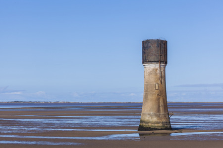 spurn: Manmade oncrete tower construction on Spurn Point Beach, nature reserve Yorkshire  UK