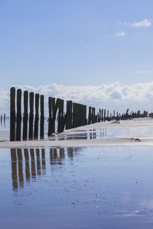 spurn: Man made wooden structures on Spurn Point beach, lonliness and isolation, Yorkshire,  UK