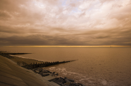 man made structure: Stormy Skies over Withernsea, at sunset in East Cost Yorkshire, UK