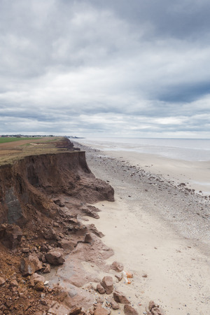 coastal erosion: Coastal Erosion caused by the sea at Withernsea, Yorkshire, UK, global environmental issues Stock Photo