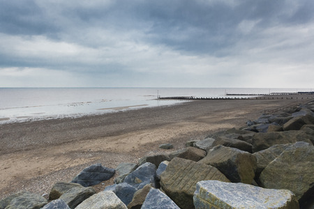 environmental issues: Concrete sea defences and wave breakers on Withernsea Beach, East Yorkshire, UK, environmental issues