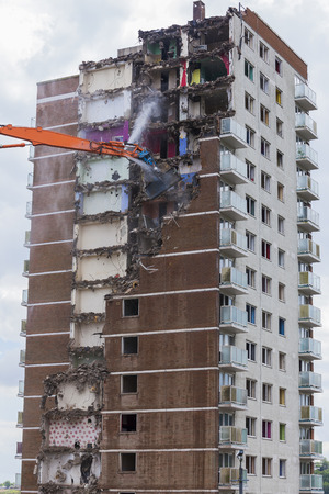 regeneration: Construction work demolishing high rise flats signifying housing and regeneration