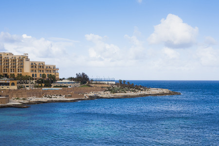 holiday destinations: Hotels on Maltese coastline showing wealth and prosperity, popular holiday destinations Editorial