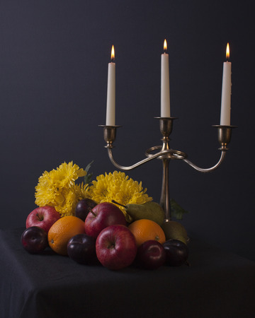 hobbies: Traditional still life arrangement of fruit, flowers, and candles in old masters style for leisure and hobbies