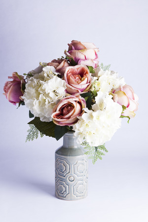 Fake silk peonies and hydrangea in vase for decoration or concepts of happiness