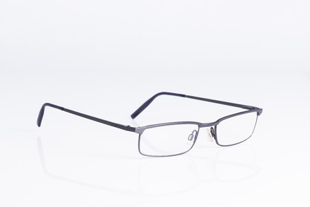 Spectacles on white background for concepts of vision and intelligence
