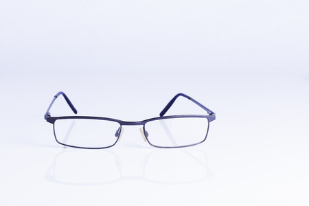 vision loss: Spectacles on white background for concepts of vision and intelligence