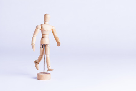Artists wooden dummy on white background, painting and drawing equipment