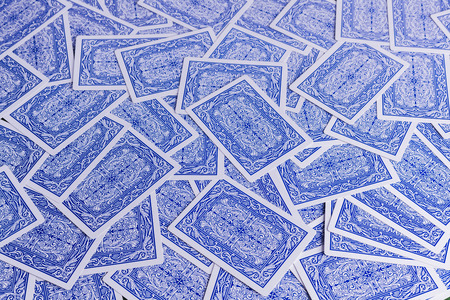 Blue and white playing card background for concepts of gambling and addiction