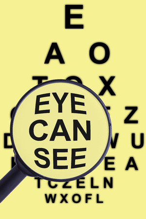 Magnifying glass and eye test for concepts of medicine and health visual aids