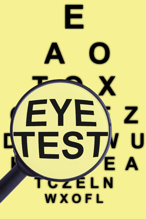 tunnel vision: Magnifying glass and eye test for concepts of medicine and health visual aids