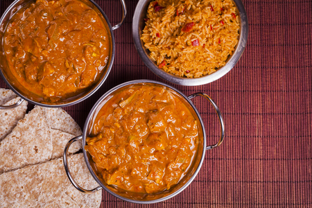Traditional Chicken Tikka Masala Curry on Rattan Background for asian cooking, takeaways and healthy eating