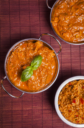piri piri: Traditional Chicken Tikka Masala Curry on Rattan Background for asian cooking, takeaways and healthy eating
