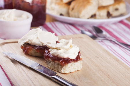 Traditional Scones with Strawberry Jam and Whipped Cream for food and nutrition, dieting and healthy eating Stock Photo