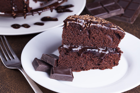 indulgence: Luxurious Rich Chocolate  Cake on White Plate for concepts of food and indulgence Stock Photo