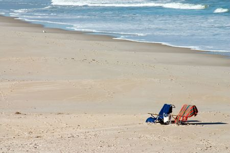Two chairs on sandy Florida beach