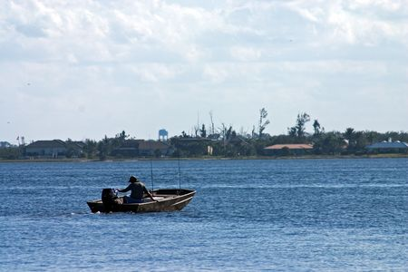 Fisherman headed out in boat on Intracoastal waterway