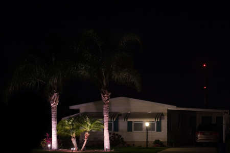 Decorative landscape lighting in front lawn of retirement home