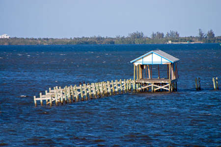 Storm Damaged Boathouse and Dock Stock Photo - 371370