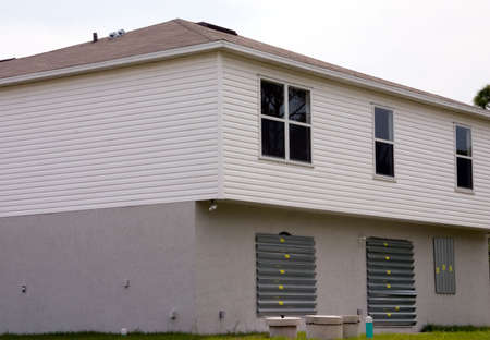 Florida house with hurricane shutters photo