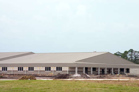 A large building under construction, soon to be new school
