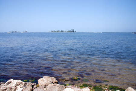Rocks bordering shoreline of intracoastal waterway of Florida