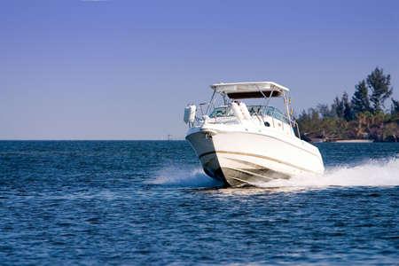 Pleasure boat cruising river photo