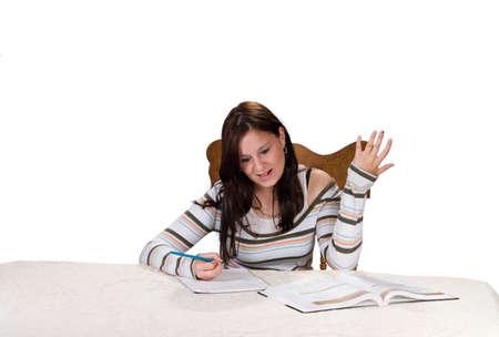 Teenage girl reacting to homework problem