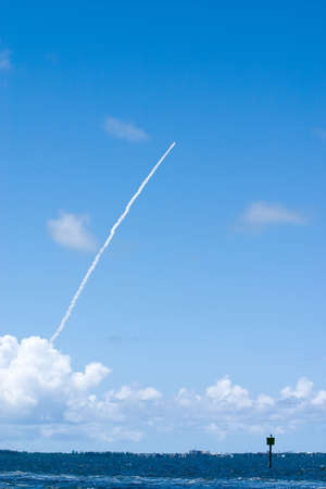 Space shuttle launch from Kennedy Space Center viewed from intracoastal waterway