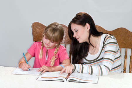 Big sister helping with homework