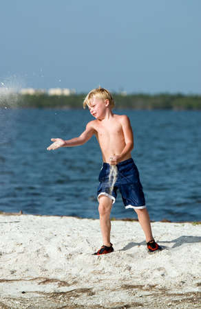sandbar: Young boy playing on sandbar Stock Photo