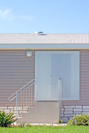 Hurricane protection poly panels installed on tropical home Stock Photo