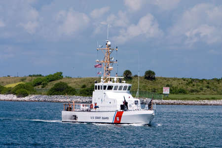 US Coast Guard boat on security patrol in sea port Stock Photo