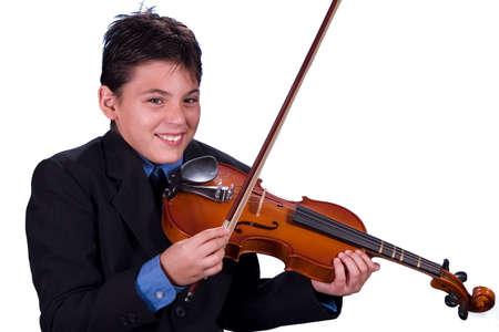 Young boy playing violin Stock Photo