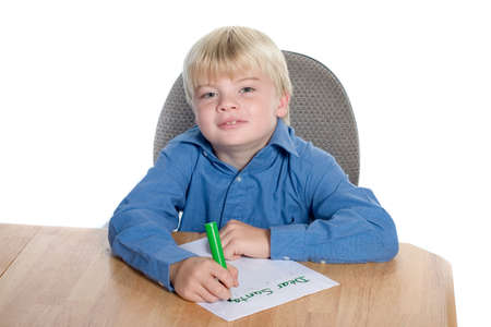 Young boy writing letter to Santa Stock Photo - 618626