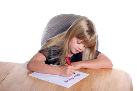 Young girl writing letter to Santa Stock Photo