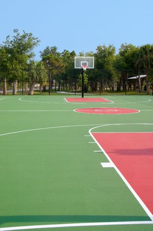 Basketball backboard and hoop at end of court