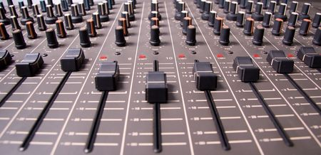 Audio mixing console sliders wide angle shot Stock Photo