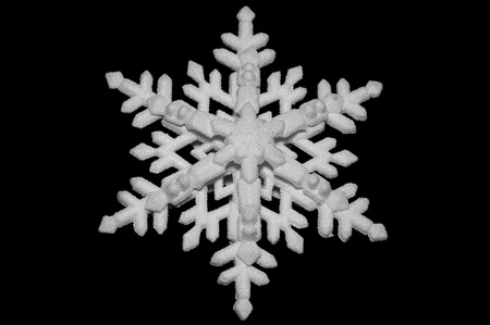 White snowflake isolated on black