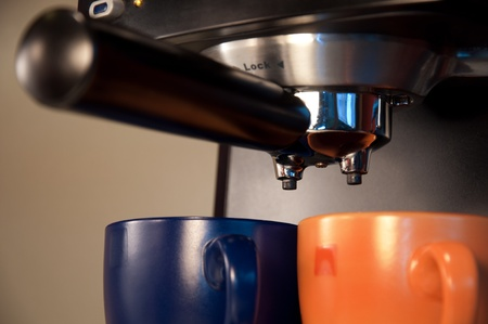 Close up of coffe machine and two cups