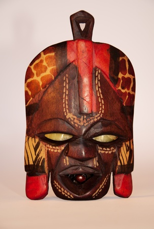 artifact: Wooden South African mask isolated on light bacground
